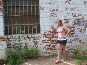 I got artistic and made sarah pose next to the cool brick wall